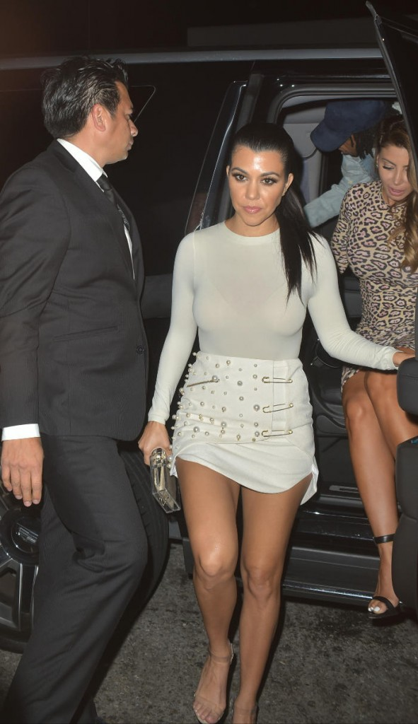 Kourtney Kardashian arrives at The Nice Guy in Los Angeles California wearing a cream leather mini-skirt