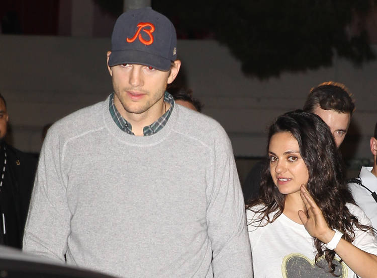 Ashton Kutcher and Mila Kunis attend Madonna Rebel Heart Tour Stop