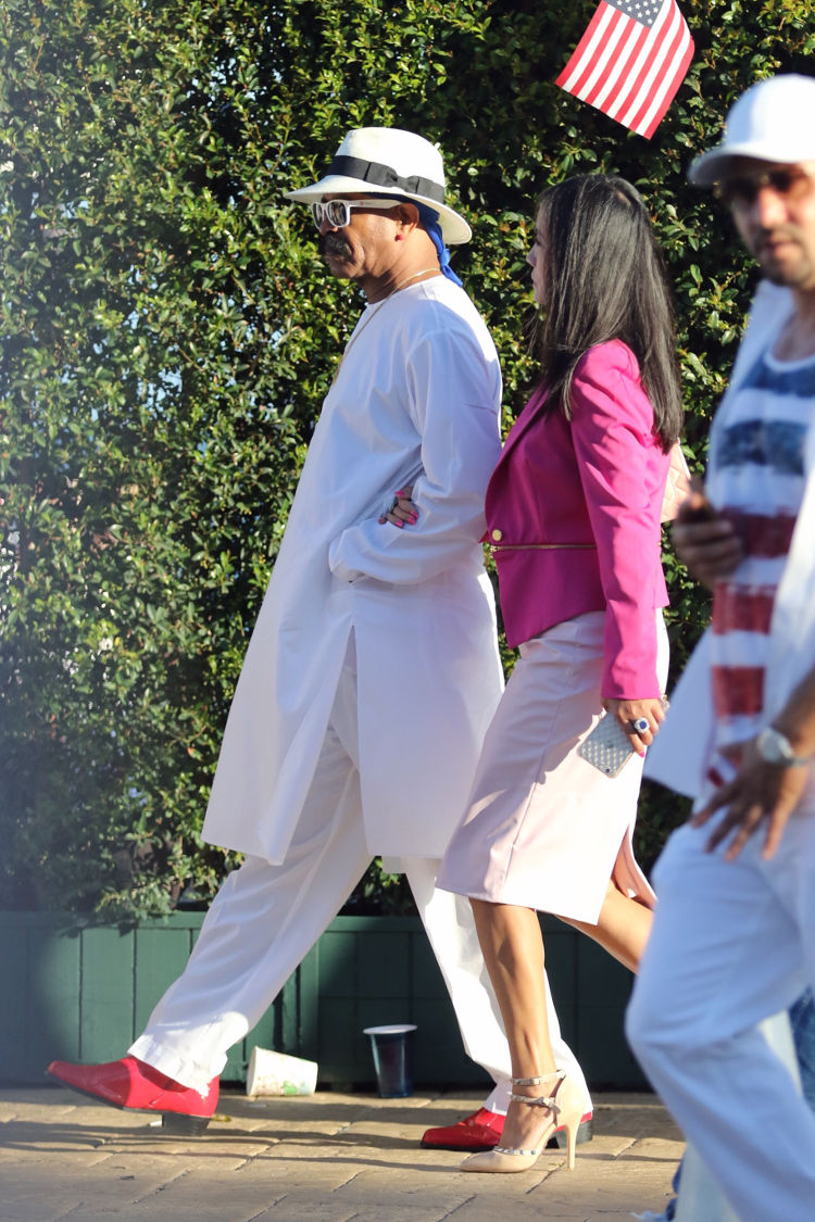 Dennis Graham, Drake dad is a ladies man at Nobu in Malibu for their 4th of July bash. He is seen arriving with a woman in pink and white