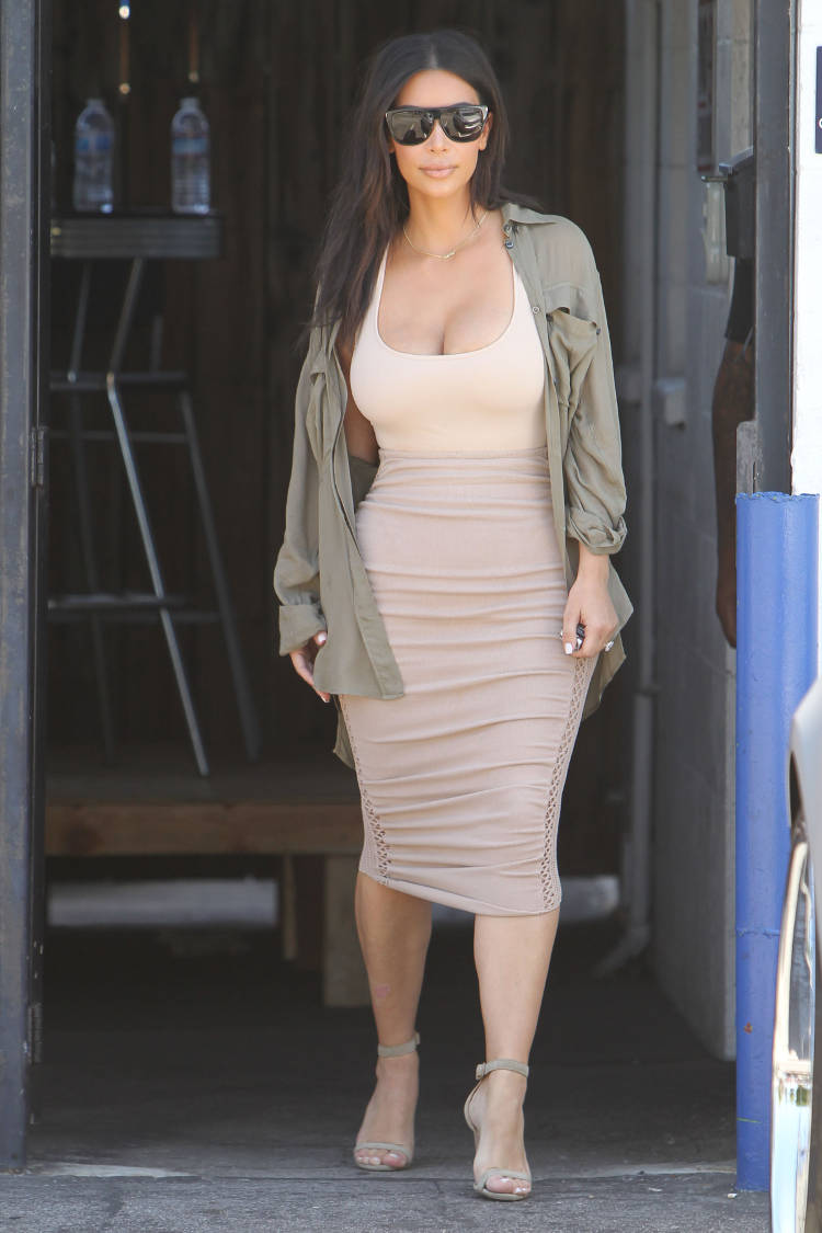 Kim Kardashian is seen leaving a studio in Los Angeles wearing a skin tight tone on tone dress