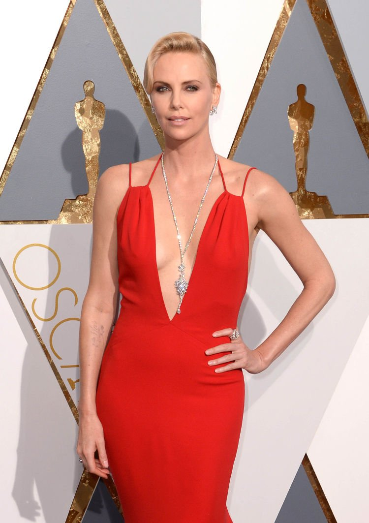 charlize theron red hot clevage