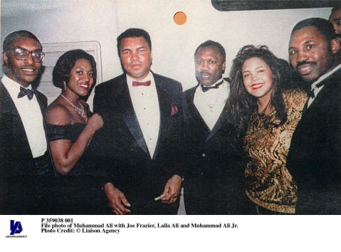Muhammad Ali with Joe Frazier, Laila Ali and Muhammad Ali Jr.