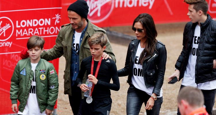 Romeo Beckham (C), Cruz Beckham (L), father David Beckham (2nd L), mother Victoria Beckham (2nd R) and brother Brooklyn Beckham (R)