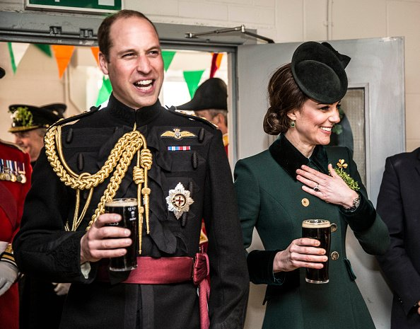 Prince William, Duke Of Cambridge and Catherine, Duchess of Cambridge take a drink of Guinness as they meet with soldiers on St. Patrick's Day 2017