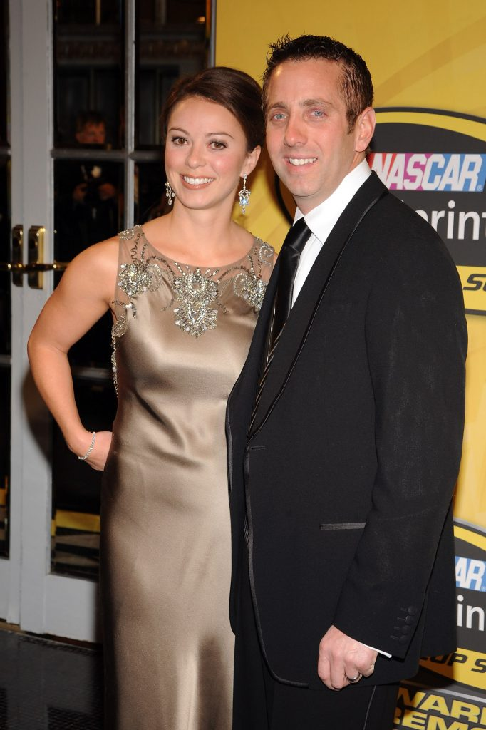 NASCAR driver Greg Biffle arrives with his wife Nicole Lunders at the NASCAR Sprint Cup Series Awards Ceremony at the Waldorf Astoria