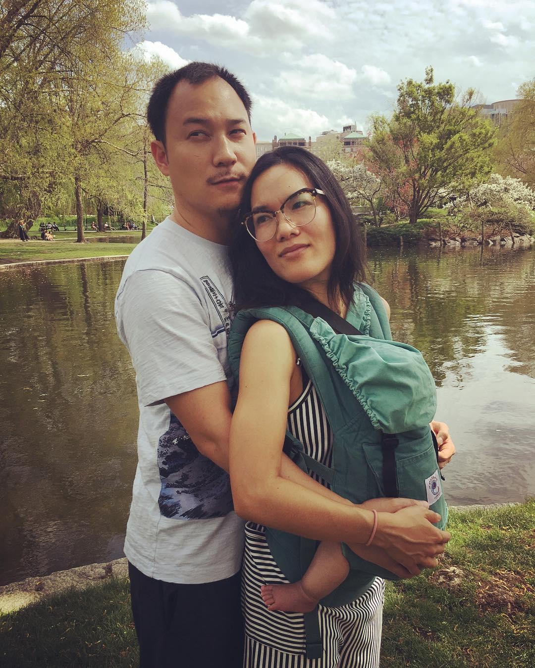 Justin Hakuta and Ali Wong posing by the riverside
