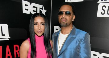 Mike Epps and Kyra Robinson attend BET's Social Awards 2018 at Tyler Perry Studio