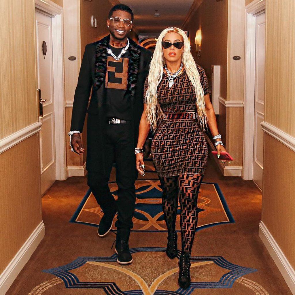 Gucci Mane & Keyshia Ka'oir Walking in a Corridor