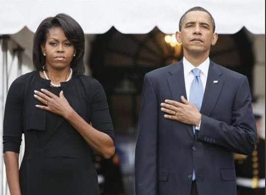 Michelle & Barrack Obama Saluting With Left Hand