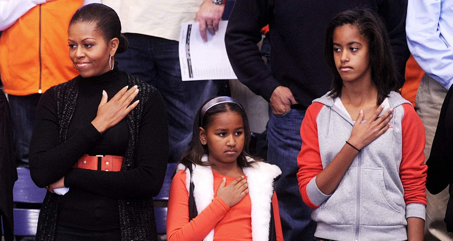 Michelle Obama Saluting Along With Her Daughters