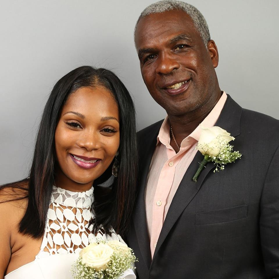 Angela Reed's with husband, Charles Oakley