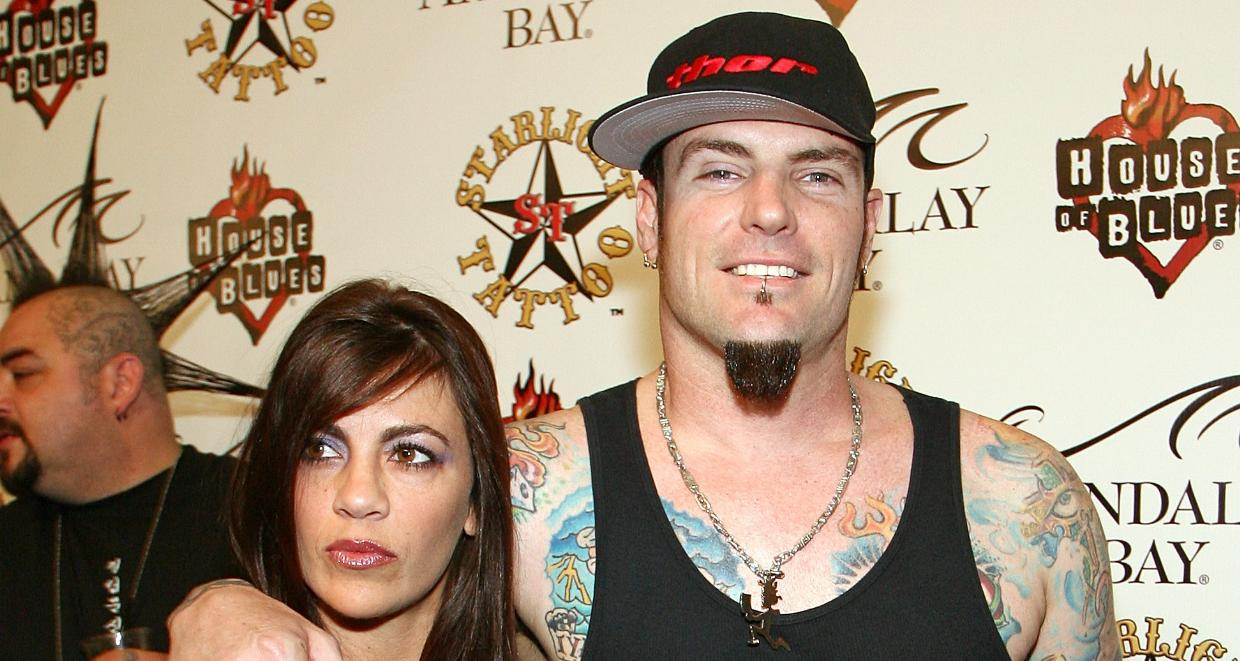 Music artist Rob 'Vanilla Ice' Van Winkle (R) and his wife Laura Van Winkle arrive at the grand opening of Mario Barth's Starlight Tattoo at the House of Blues