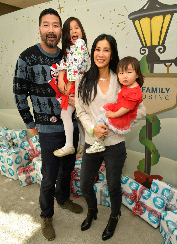 (Left to Right) Paul Song, Jett Ling Song, Lisa Ling, and Ray Ling Song at the 7th Annual Santa's Secret Workshop