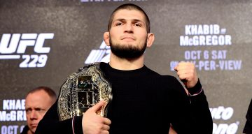 Lightweight Champion Khabib Nurmagomedov poses for photos during the UFC 229 Press Conference